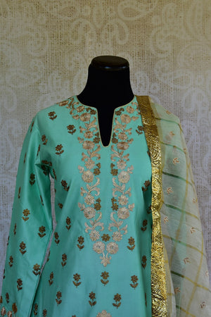 501336, Shop this traditional Indian navy blue and golden kurta set online or from our Pure Elegance store in Edison near NJ. Ideal for wedding party, reception, sangeet. Close up.