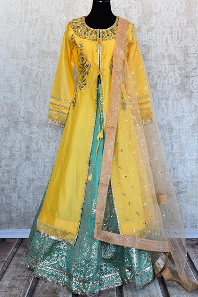 Designer Readymade  embroidered Khari print chanderi silk yellow and green skirt kurta set available at our store and online. This Indian outfit is very classy.-Full set all together