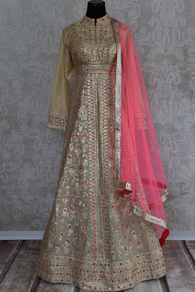 Beige fully embroidered designer anarkali suit comes with pink net dupatta . Perfect for wedding party and festivals.-full view