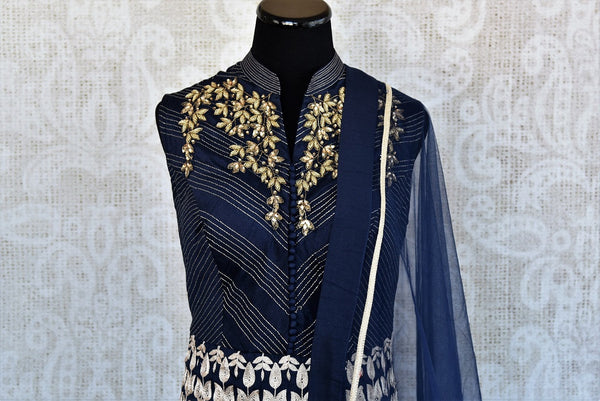 Shop Navy blue Indian ready made embroidered double layered anarkali suit with dupatta online and in store at Pure Elegance, perfect for parties and festivals.-embroidered neck view
