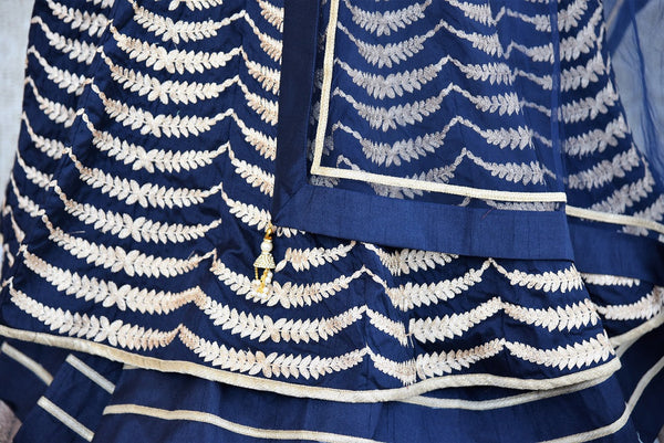 Shop Navy blue Indian ready made embroidered double layered anarkali suit with dupatta online and in store at Pure Elegance, perfect for parties and festivals.-close up of layers