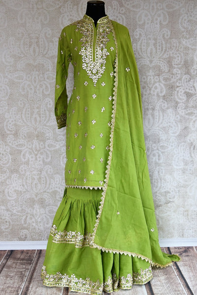 Buy this gorgeous green silk indian sharara suit with gota patti embroidery and dupatta from pure elegance online. Great for parties and festive occasions.-Full View