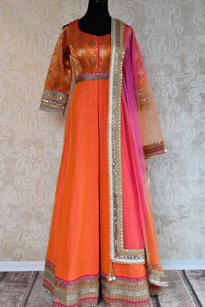 Buy this elegant and eye catching orange banarasi raw silk floor length indian suit with dupatta from pure elegance store. Great for parties and festive occasions- Full View