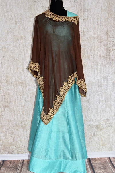Buy this gorgeous blue floor-length georgette silk indian dress suit with brown poncho top with embroidered border from pure elegance store. Great for parties-Full View