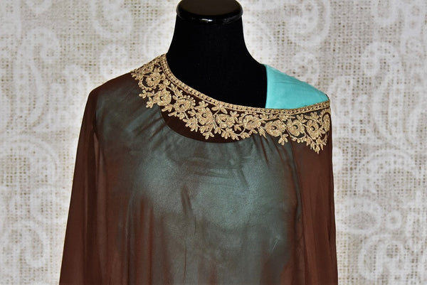 Buy this gorgeous blue floor-length georgette silk indian dress suit with brown poncho top from pure elegance store. Great for parties-Poncho Top & Border Design