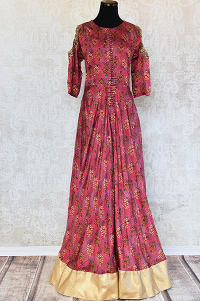Floral printed satin suit in red with zari embroidered cold shoulder and gold border. Ideal for evening parties.-full view