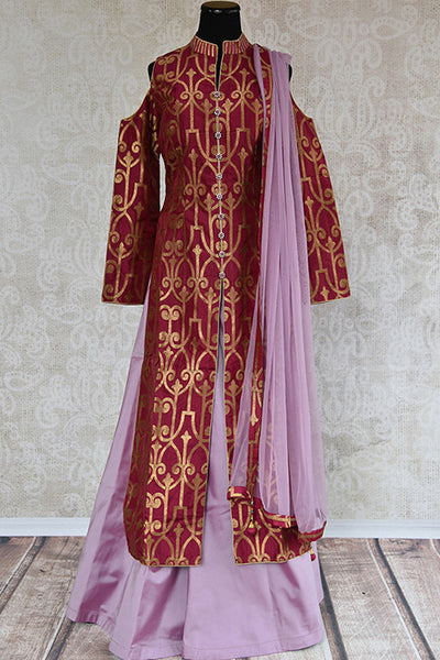 Buy Purple banarasi suit with solid palazzo with abundance of hem. This party suit has front slit and cold shoulder design.-Full view