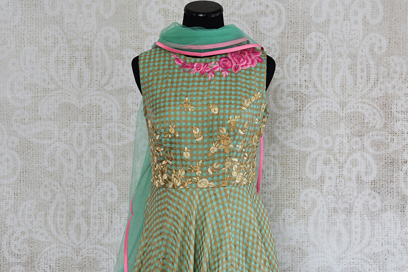 Green chanderi silk anarkali with thread embroidery on bodice. Perfect elegant and classy dress for parties.- top embroidered view
