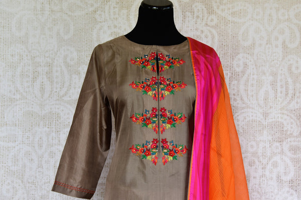 Buy Elegant Brown Silk Suit with Orange Dupatta online from Pure Elegance Store. Beautiful collection of ethnic Indian Salwar Kameez, Churidar Suits online in USA.-front
