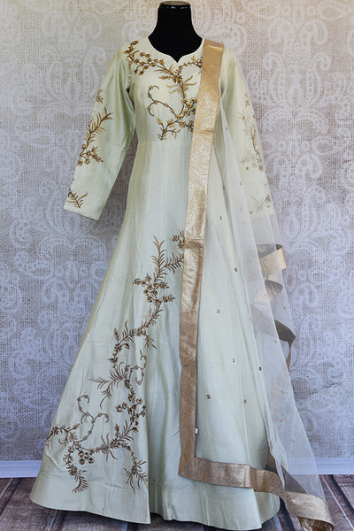 Off white silk embroidered anarkali with net dupatta. Classy addition in ethnic wardrobe.-full view