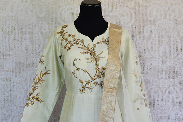 Off white silk embroidered anarkali with net dupatta. Classy addition in ethnic wardrobe.-front bodice