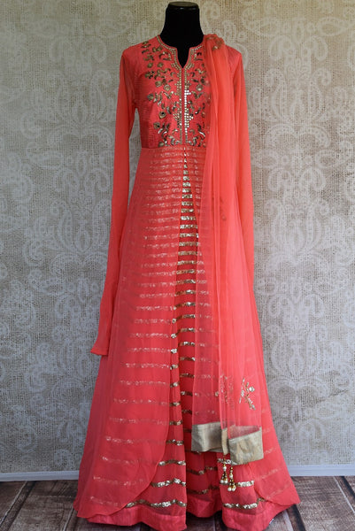 Buy designer Pink Raw Silk floor length Anarkali suit online with beautiful mirror work.  Pure Elegance presents elegant Indian Anarkali suits online & in store. -full view