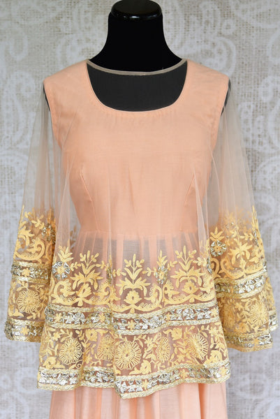 Buy peach chanderi cotton dress with embroidered net poncho online from Pure Elegance. Our store brings stylish designer Indian dresses online for women in USA.-poncho