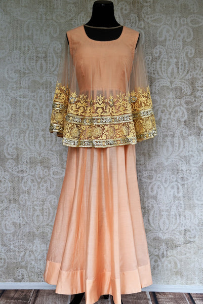 Buy peach chanderi cotton dress with embroidered net poncho online from Pure Elegance. Our store brings stylish designer Indian dresses online for women in USA.-full view