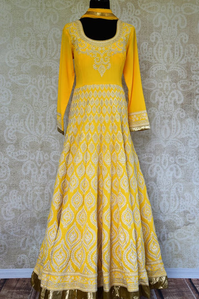 Buy yellow georgette embroidered floor length Anarkali suit online in USA with dupatta from Pure Elegance. Our store brings you Indian designer suits for every occasion.-full view