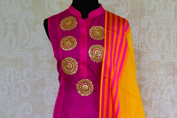 Buy pink gota patti embroidered silk suit online from Pure Elegance with dupatta. Our fashion store brings stunning Indian salwar suits in USA for women for every occasion.-top