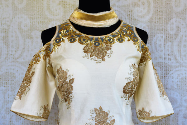 Buy off white embroidered suit with palazzo online in USA. Pure Elegance clothing store brings a stylish range of Indian designer suits for online shopping in USA. -top front