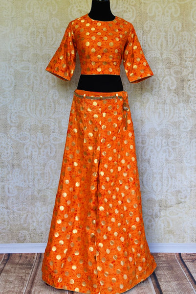 Buy orange Banarasi palazzo with crop top online in USA. Pure Elegance fashion store brings a stunning collection of Indian designer dresses in USA for parties and weddings.-full view
