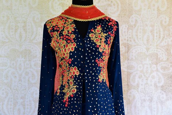 Buy navy blue embroidered georgette kurta with skirt online at Pure Elegance. Our fashion store brings exquisite range of designer Indian dresses in USA for women.-top front