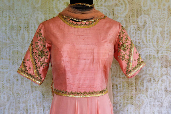 Buy pink embroidered georgette and raw silk Anarkali suit online in USA. Pure Elegance store brings exquisite range of designer Indian Anarkali suits in USA for every occasion.-top front