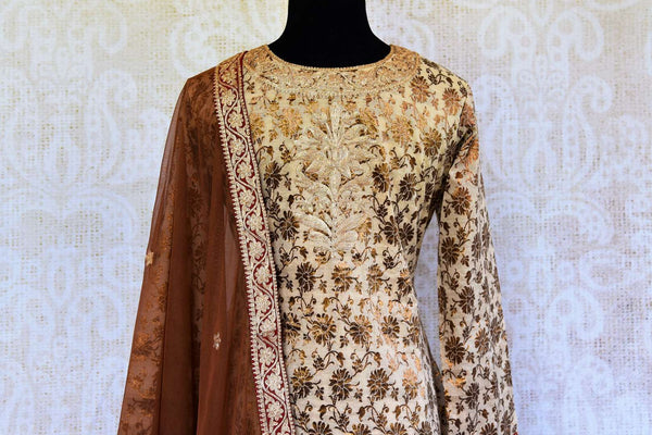 Buy cream and brown khari print salwar suit online in USA with dupatta. Pure Elegance fashion store brings an exclusive range of ethnic Indian salwar suits in USA.-top back
