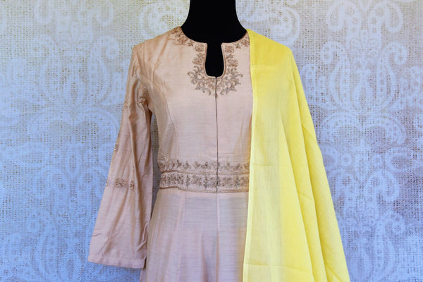 Buy cream embroidered chanderi Anarkali suit online in USA with dupatta. Pure Elegance fashion store brings an exclusive range of Indian designer Anarkali suits in USA.-top front