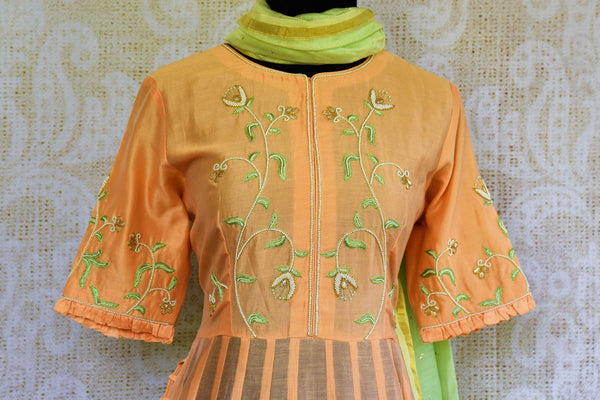 Buy peach embroidered chanderi suit online in USA. Pure Elegance clothing store brings an exquisite collection of Indian designer suits for parties and weddings.-top front
