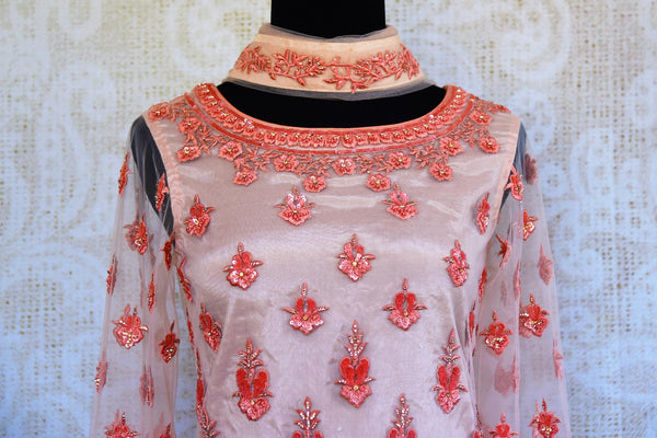Buy peach embroidered net georgette sharara online in USA. Pure Elegance clothing store brings an exquisite range of Indian designer wedding dresses in USA. Shop online.-top front
