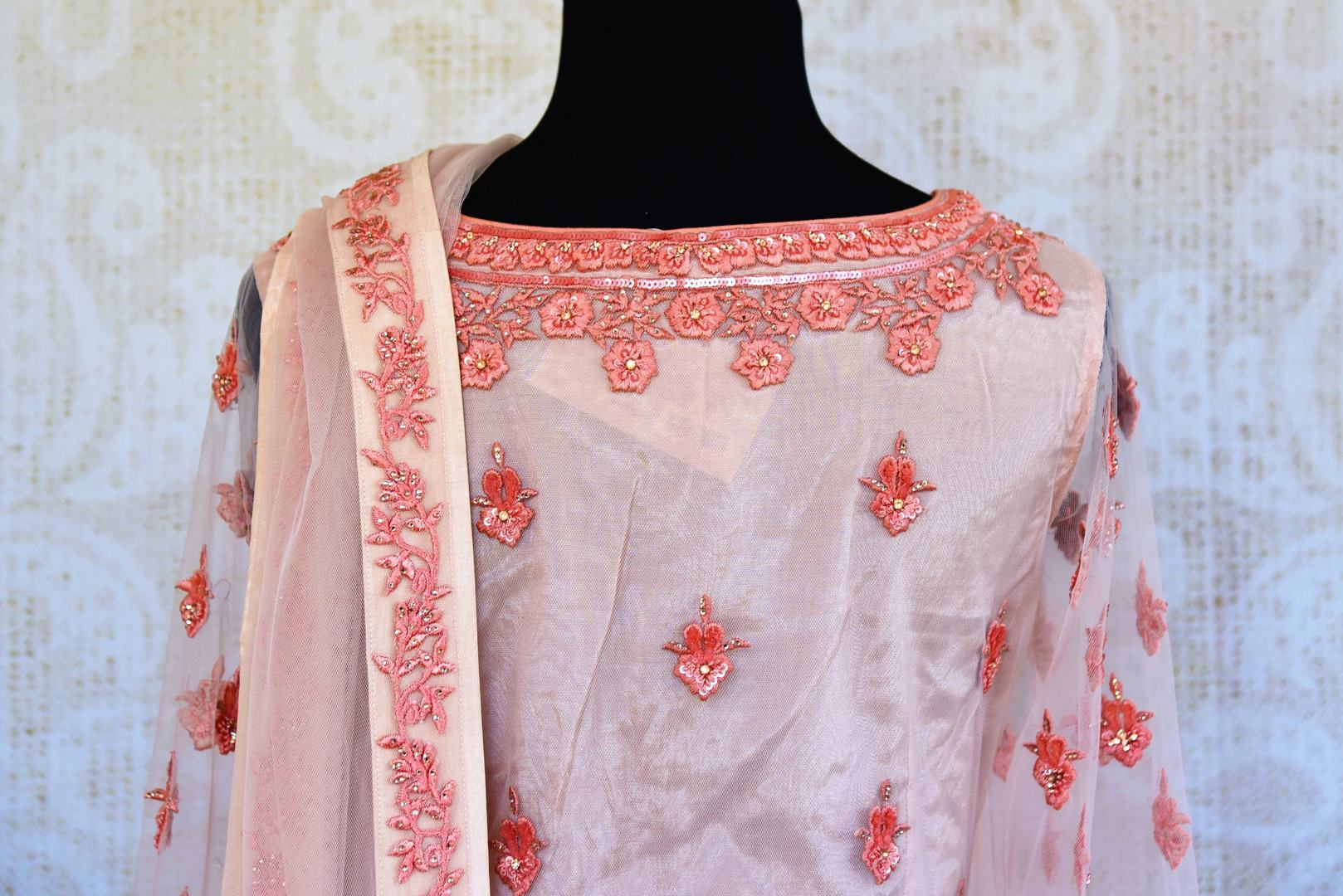 Buy peach embroidered net georgette sharara online in USA. Pure Elegance clothing store brings an exquisite range of Indian designer wedding dresses in USA. Shop online.-back