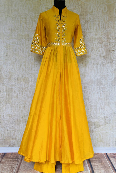 Buy yellow chanderi gota patti suit with palazzo online in USA. Pure Elegance fashion store brings exquisite collection of Indian designer wedding suits in USA for women.-full view