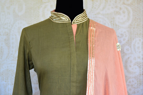 Buy green and pink embroidered kurta and skirt with dupatta online in USA. Pure Elegance clothing store brings an exquisite range of Indian designer dresses in USA. -front top