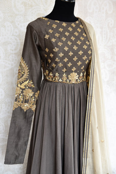 Buy elegant embroidered dark grey chanderi floor length Anarkali online in USA. The attire is beautifully adorned with zardozi work which makes it so exquisite. Get floored by an exclusive collection of Indian designer Anarkali suits in USA available at Pure Elegance clothing store or shop online.-side view