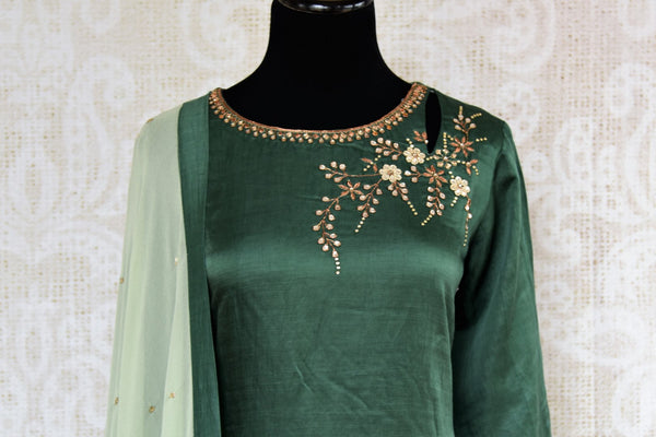 Buy beautiful embroidered green chanderi kurta with palazzo online in USA. The attire is beautifully adorned with kundan work which makes it so exquisite. Get floored by an exclusive collection of Indian formal dresses in USA available at Pure Elegance clothing store or shop online.-front