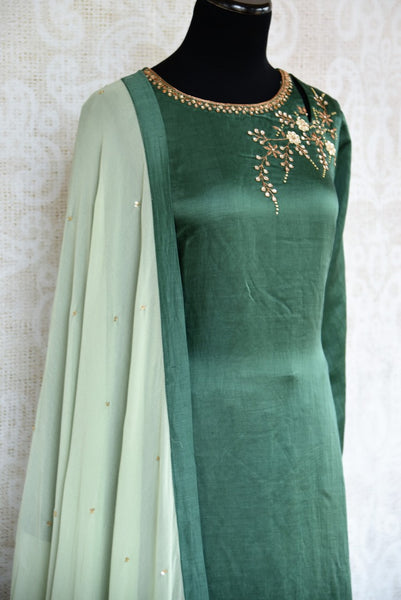 Buy beautiful embroidered green chanderi kurta with palazzo online in USA. The attire is beautifully adorned with kundan work which makes it so exquisite. Get floored by an exclusive collection of Indian formal dresses in USA available at Pure Elegance clothing store or shop online.-side view