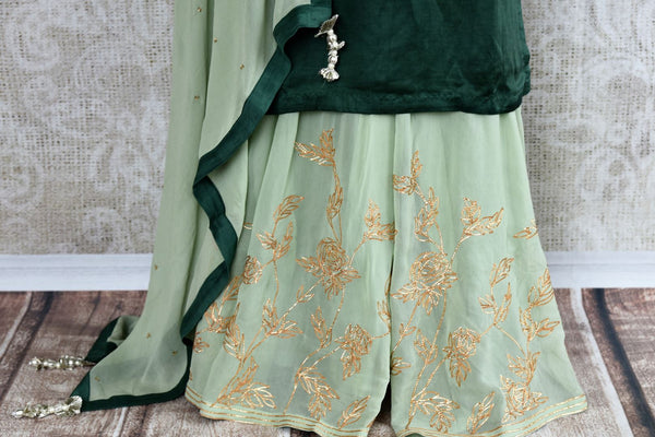 Buy beautiful embroidered green chanderi kurta with palazzo online in USA. The attire is beautifully adorned with kundan work which makes it so exquisite. Get floored by an exclusive collection of Indian formal dresses in USA available at Pure Elegance clothing store or shop online.-palazzo