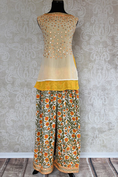 Buy cream and yellow embroidered georgette kurta with palazzo online in USA. The Indo-western outfit is a stylish and unique choice for special occasions. Get floored by an exclusive collection of Indian formal dresses in USA available at Pure Elegance clothing store or shop online.-full view