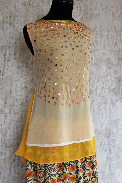Buy cream and yellow embroidered georgette kurta with palazzo online in USA. The Indo-western outfit is a stylish and unique choice for special occasions. Get floored by an exclusive collection of Indian formal dresses in USA available at Pure Elegance clothing store or shop online.-side view