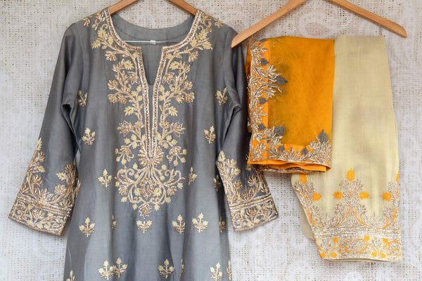 Buy grey embroidered chanderi sharara with dupatta online in USA. The traditional outfit is a beautiful choice for special occasions. Get floored by an exclusive collection of Indian traditional dresses in USA available at Pure Elegance clothing store or shop online.-kurta and sharara