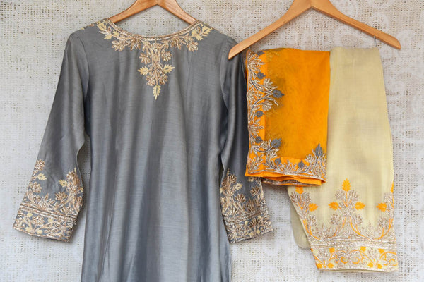 Buy grey embroidered chanderi sharara with dupatta online in USA. The traditional outfit is a beautiful choice for special occasions. Get floored by an exclusive collection of Indian traditional dresses in USA available at Pure Elegance clothing store or shop online.-closeup