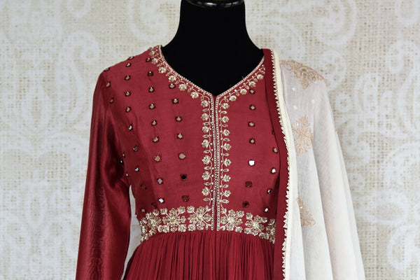 Buy maroon embroidered chanderi suit with dupatta online in USA. The traditional outfit is a stunning choice for parties and special occasions. Get floored by an exclusive collection of Indian designer Anarkali suits in USA available at Pure Elegance clothing store or shop online.-front