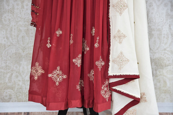 Buy maroon embroidered chanderi suit with dupatta online in USA. The traditional outfit is a stunning choice for parties and special occasions. Get floored by an exclusive collection of Indian designer Anarkali suits in USA available at Pure Elegance clothing store or shop online.-panel
