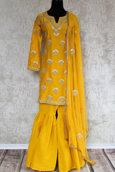 Buy yellow gota patti embroidery sharara suit with dupatta online in USA. The traditional outfit is a stunning choice for parties and special occasions. Get floored by an exclusive collection of Indian designer suits in USA available at Pure Elegance clothing store or shop online.-full view