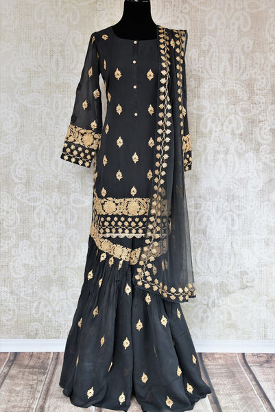 Buy dark grey embroidered georgette sharara suit with dupatta online in USA. The traditional outfit is a stunning choice for parties and special occasions. Get floored by an exclusive collection of Indian designer suits in USA available at Pure Elegance clothing store or shop online.-full view