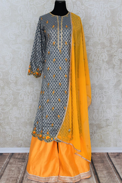 Buy grey and yellow embroidered sharara suit with dupatta online in USA. Add brilliance to your Indian ethnic look with an exquisite range of designer dresses, suits available at Pure Elegance exclusive clothing store in USA or shop online.-full view