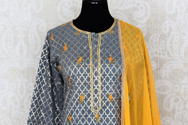 Buy grey and yellow embroidered sharara suit with dupatta online in USA. Add brilliance to your Indian ethnic look with an exquisite range of designer dresses, suits available at Pure Elegance exclusive clothing store in USA or shop online.-kurta front