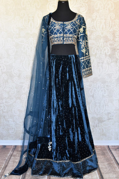 Buy elegant blue embroidered velvet lehenga online in USA with dupatta. The lehenga is perfect for rich Indian ethnic look at weddings. Make your Indian clothing collection exquisite with beautiful Indian designer wedding lehengas, designer dresses available at Pure Elegance clothing store in USA or shop online.-full view