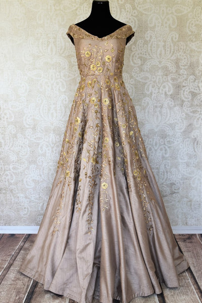 Channel your dreamy princess moment in this handcrafted gold silk floor-length Indo-western dress. It comes with a sweetheart neckline and intricate floral embroidery to notch up your sartorial style. Shop designer dresses, sarees, anarkali suits online or visit Pure Elegance store, USA. -full view