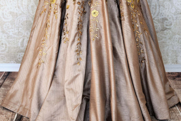 Channel your dreamy princess moment in this handcrafted gold silk floor-length Indo-western dress. It comes with a sweetheart neckline and intricate floral embroidery to notch up your sartorial style. Shop designer dresses, sarees, anarkali suits online or visit Pure Elegance store, USA. -skirt