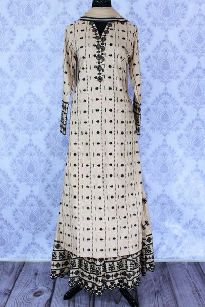 Elegant beige embroidered kurta with skirt for online shopping in USA. A perfect choice to keep a simple and ethnic at special occasions. Add latest Indian party dresses to your ethnic wardrobe available at Pure Elegance Clothing store in USA for women.-full view