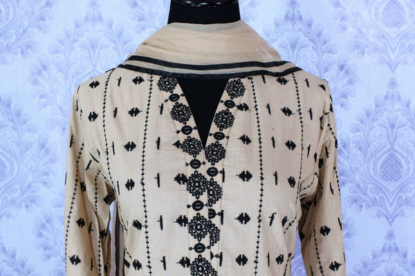 Elegant beige embroidered kurta with skirt for online shopping in USA. A perfect choice to keep a simple and ethnic at special occasions. Add latest Indian party dresses to your ethnic wardrobe available at Pure Elegance Clothing store in USA for women.-front